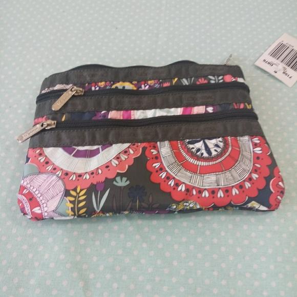 Lesportsac Handbags - LesportSac 3 zipper Cosmetic bag NWT
